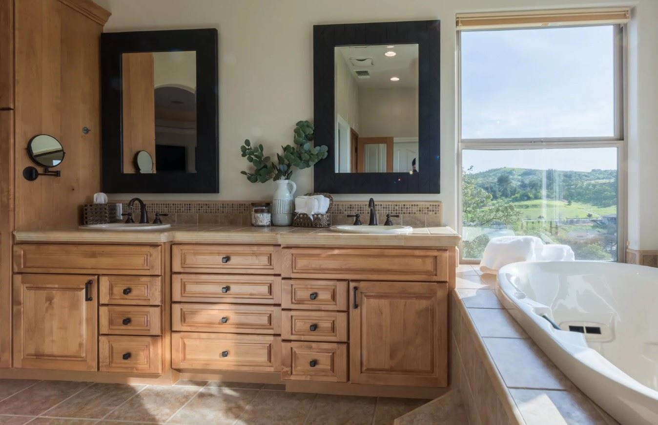 Hilltop Hacienda - Interior - Bathroom with a large dual sink countertop and a tub with a View