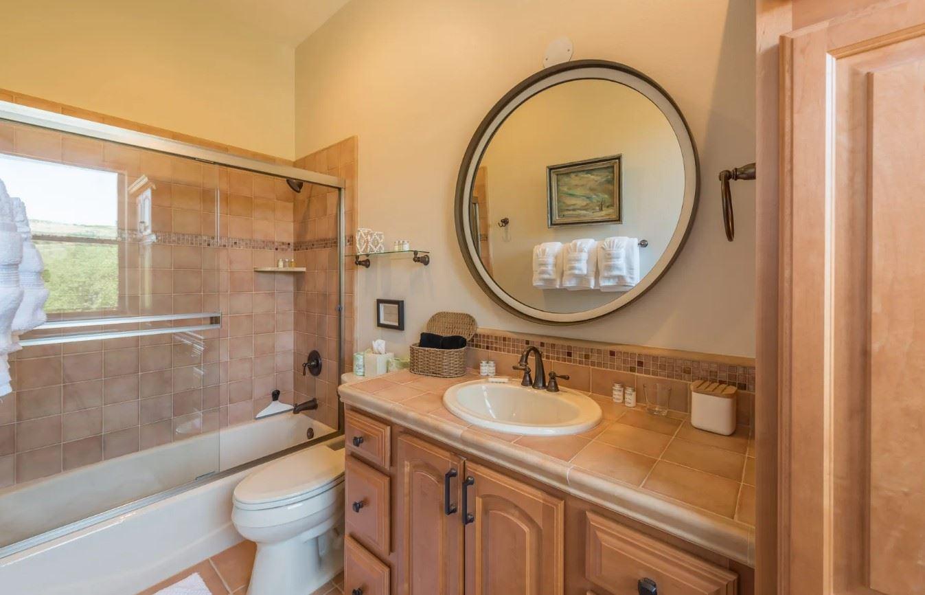 Hilltop Hacienda - Interior - Bathroom with tub and shower combo