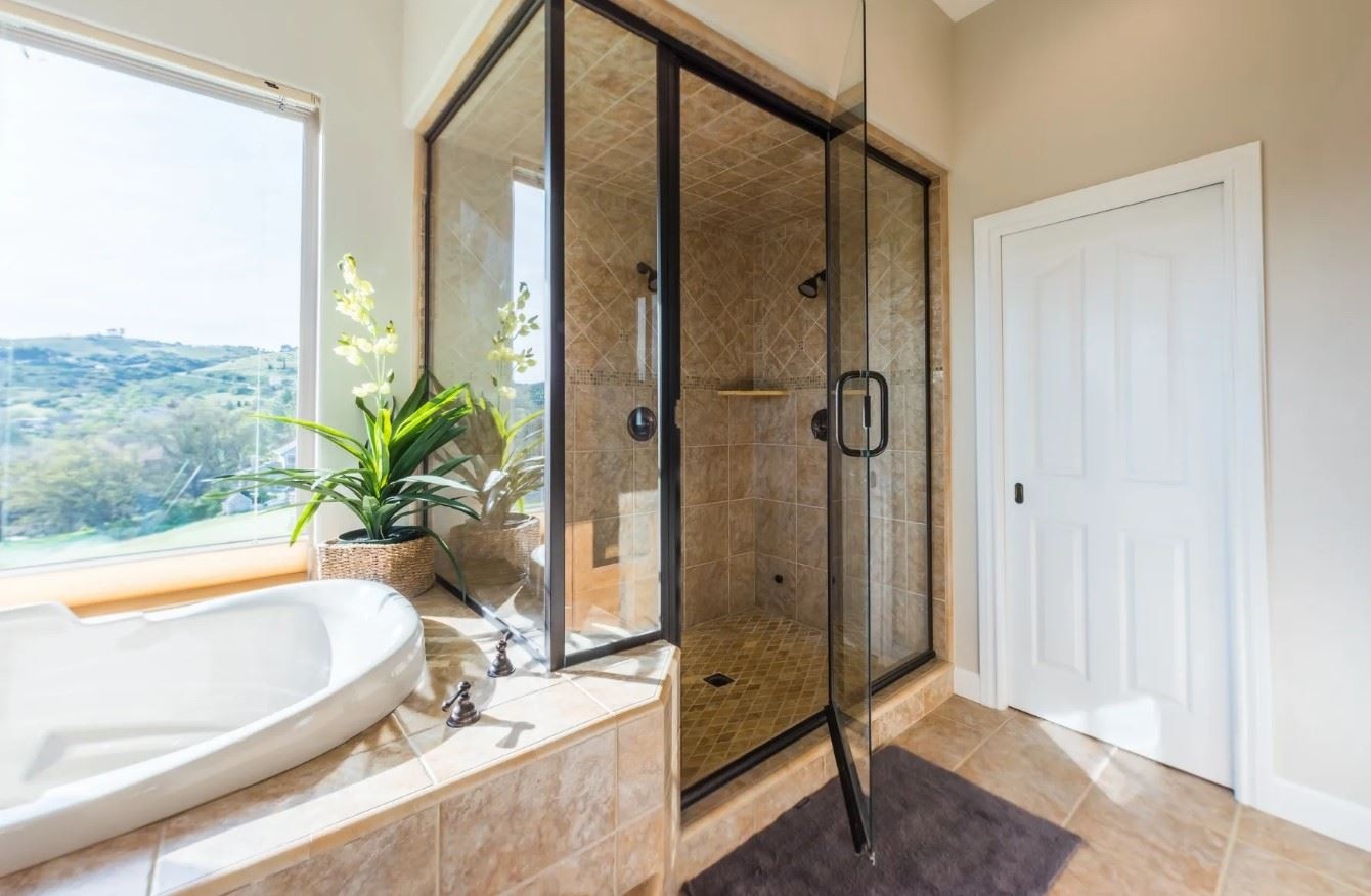 Hilltop Hacienda - Interior - Bathroom with tub that has a hillside view and a large shower