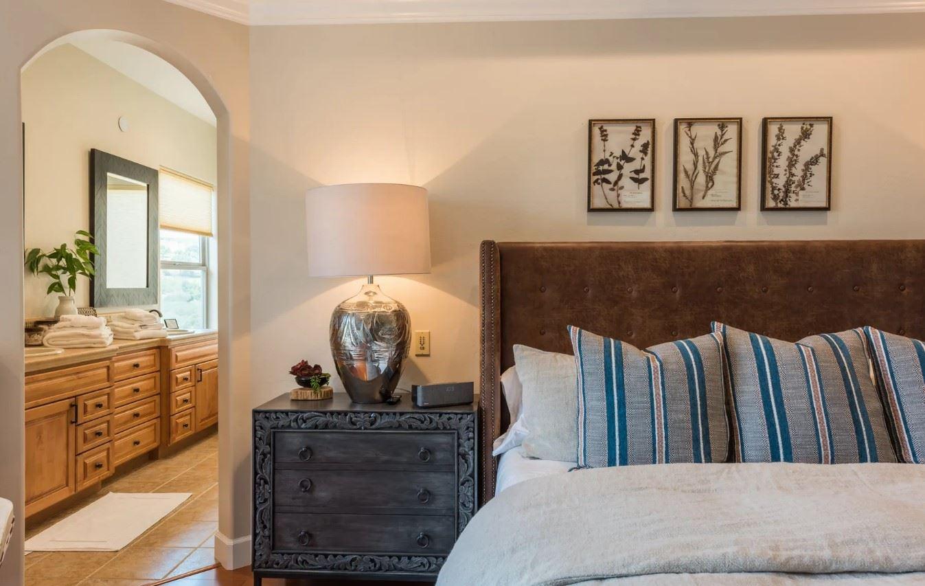 Hilltop Hacienda - Interior - Bedroom side view with view into bathroom