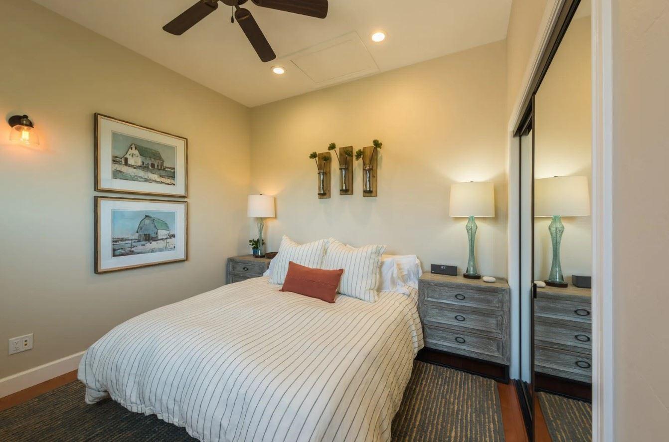 Hilltop Hacienda - Interior - Bedroom with dark birch endtables and light decor