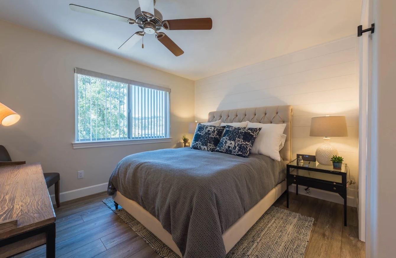 Hilltop Hacienda - Interior - Bedroom with dark linens and desk