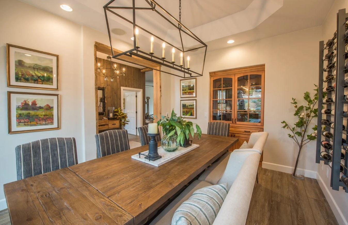 Hilltop Hacienda - Interior - Dining Room with Seating for 9 and wine rack on wall- Close Up
