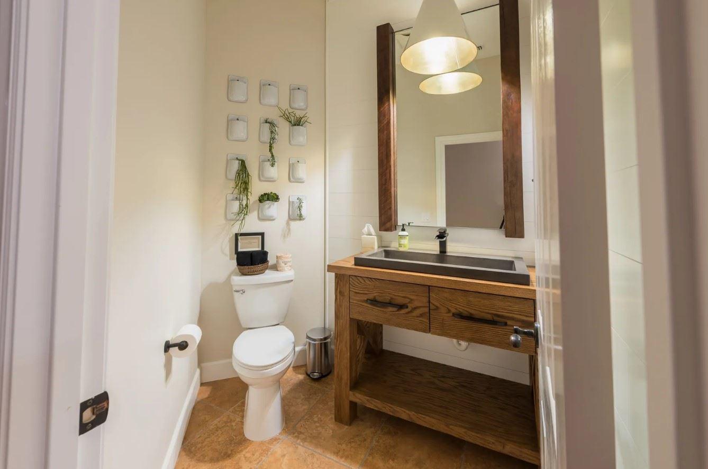 Hilltop Hacienda - Interior - Half Bathroom with corner toilet and sink