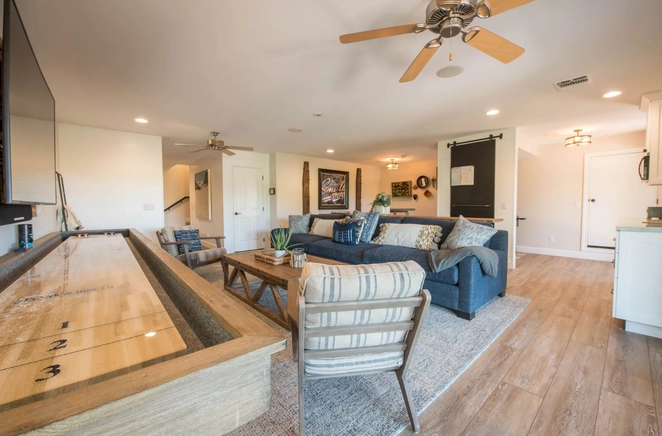 Hilltop Hacienda - Interior - Living Area with Shuffleboard table and TV