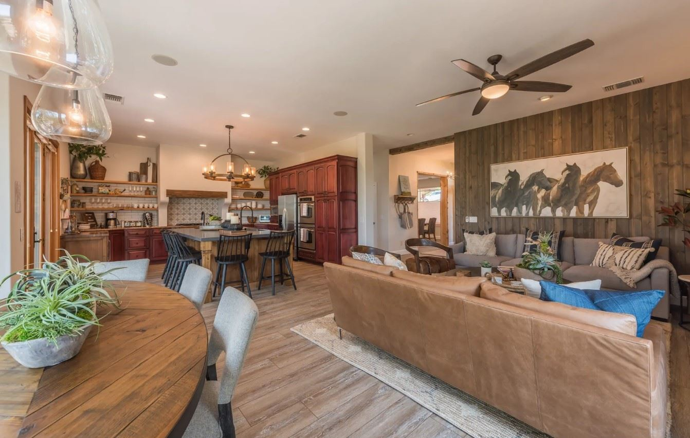 Hilltop Hacienda - Interior - Living Room with seating as well as dining and kitchen
