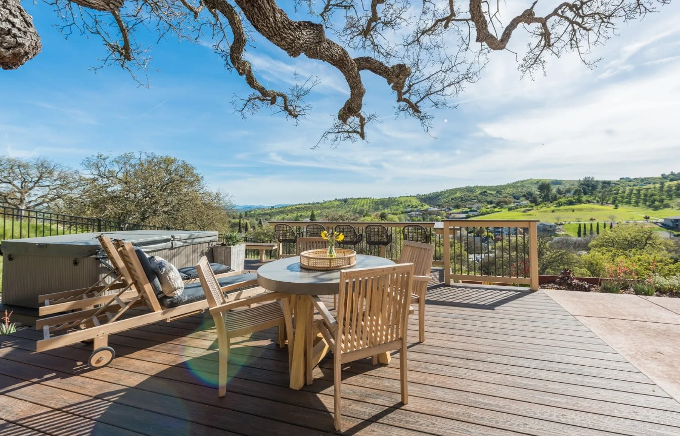 Hilltop Hacienda - Porch Small Table by Loungers and Hot Tub Under Tree