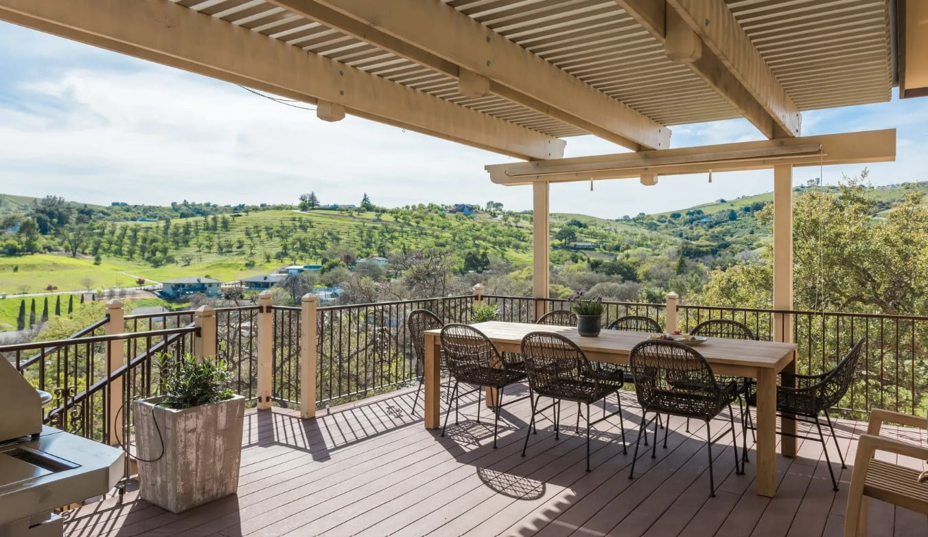 Hilltop Hacienda - Porch - Trellis covers the upper deck patio with table and seating for 8