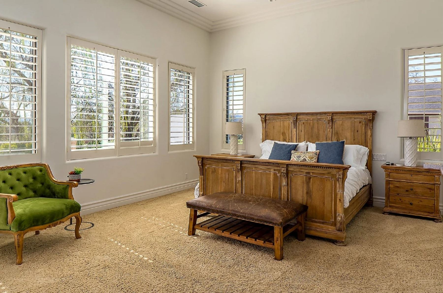 Frontier Farmhouse - Interior - Bedroom with seating area and large windows