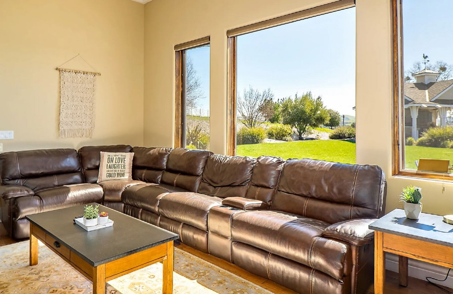 Frontier Farmhouse - Interior - Extra large leather sectional in front of three tall windows