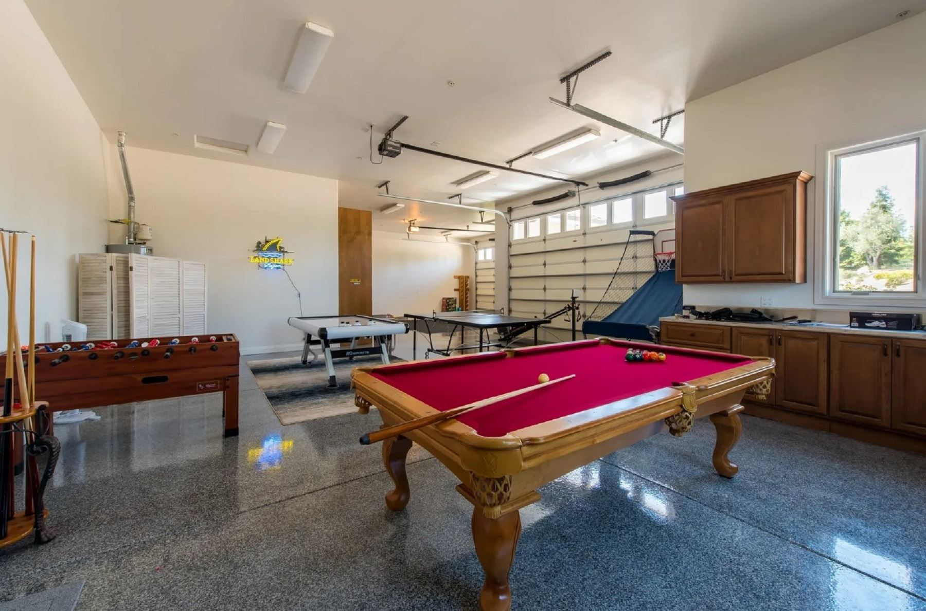 Frontier Farmhouse - Interior - Garage wtih a myriad of table games from pool to pingpong