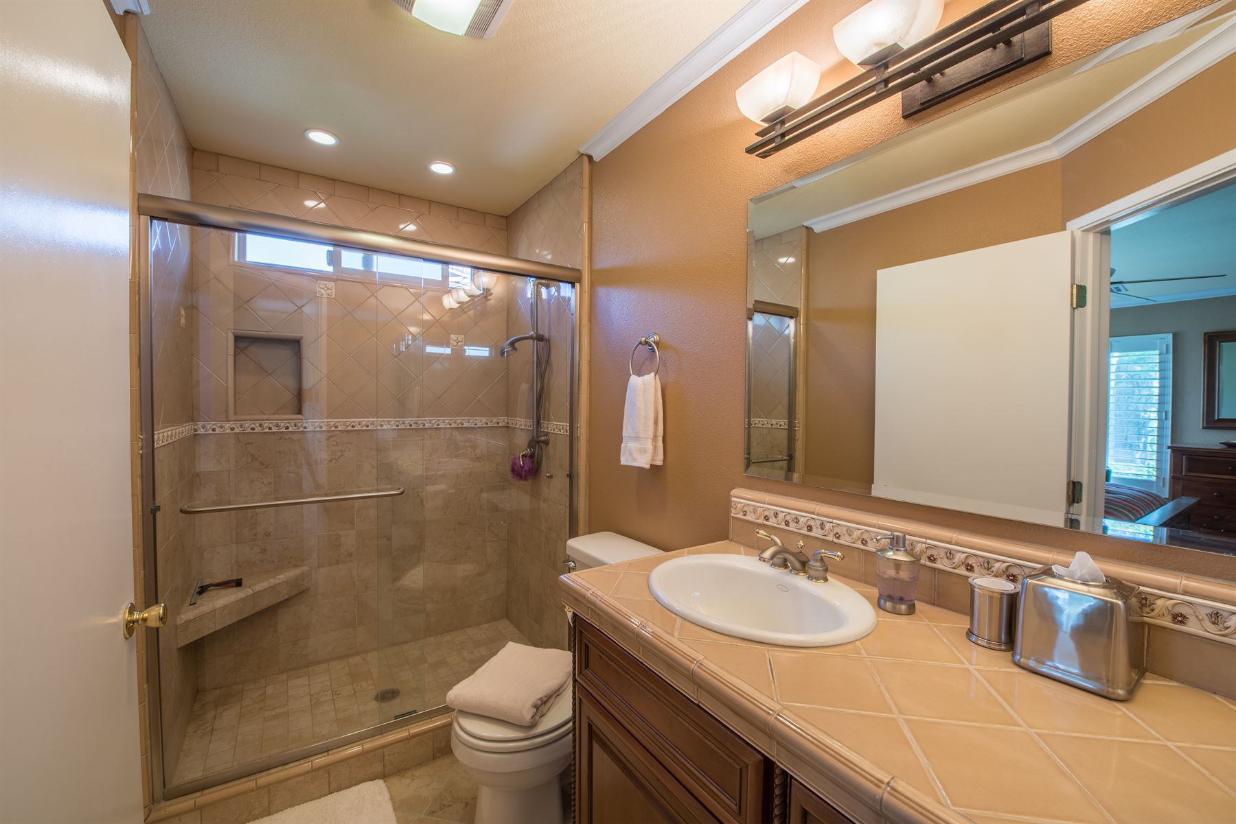Golfer's Getaway - Interior - Bathroom with single sink and standing shower that has a toilet tucked between them along the wall