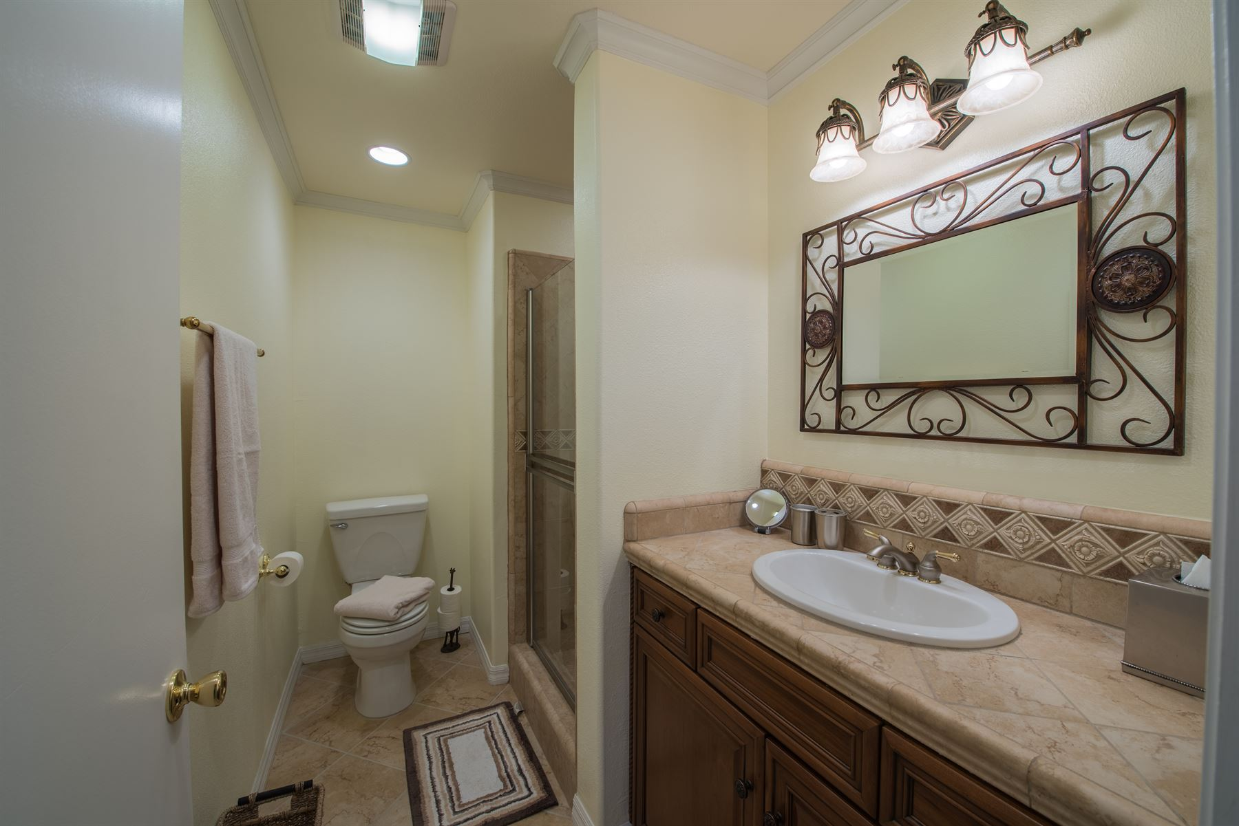 Golfer's Getaway - Interior - Bathroom with a single sink and a toilet along far wall and standing shower next to it