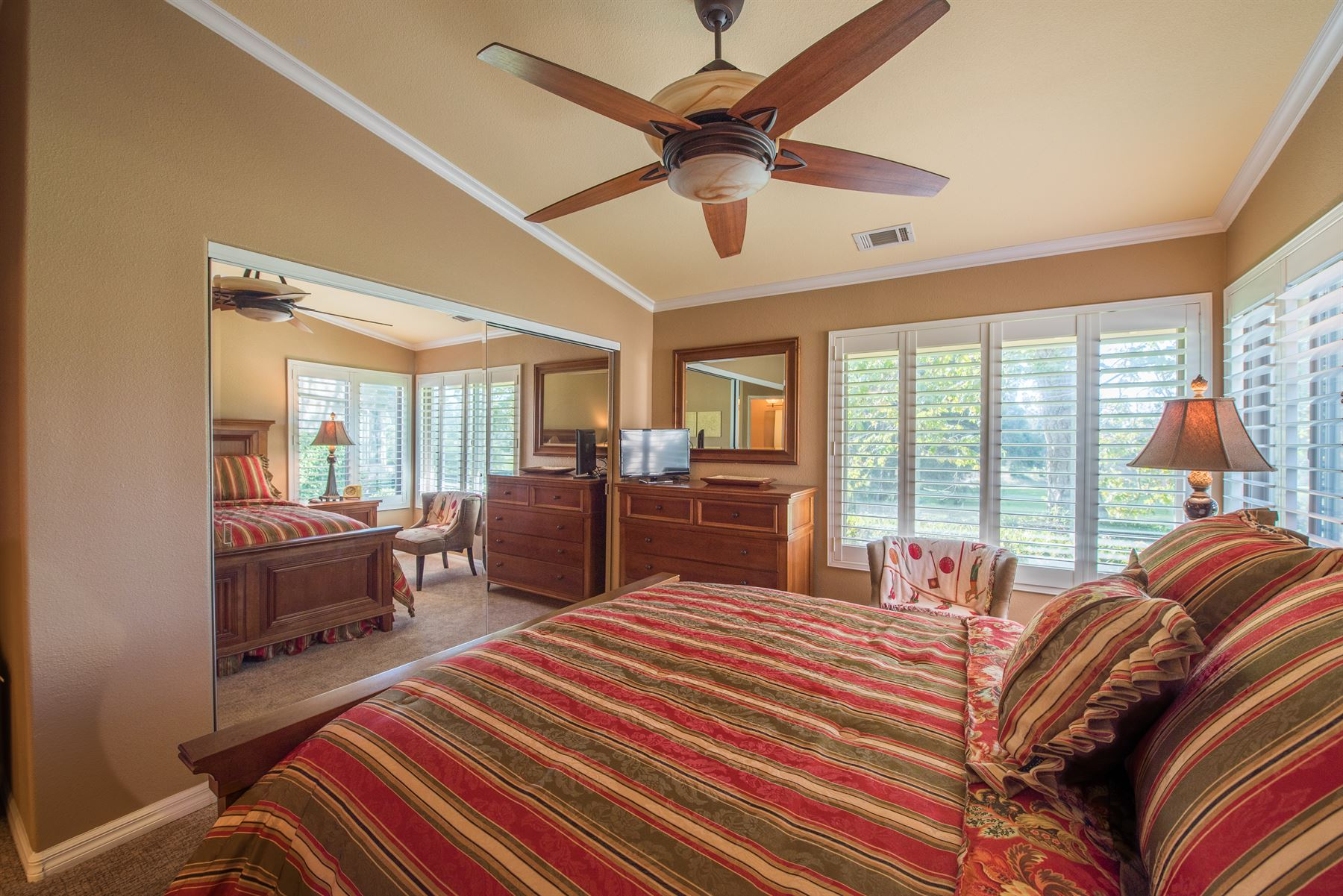 Golfer's Getaway - Interior - Bedroom with large bed and seating area by window