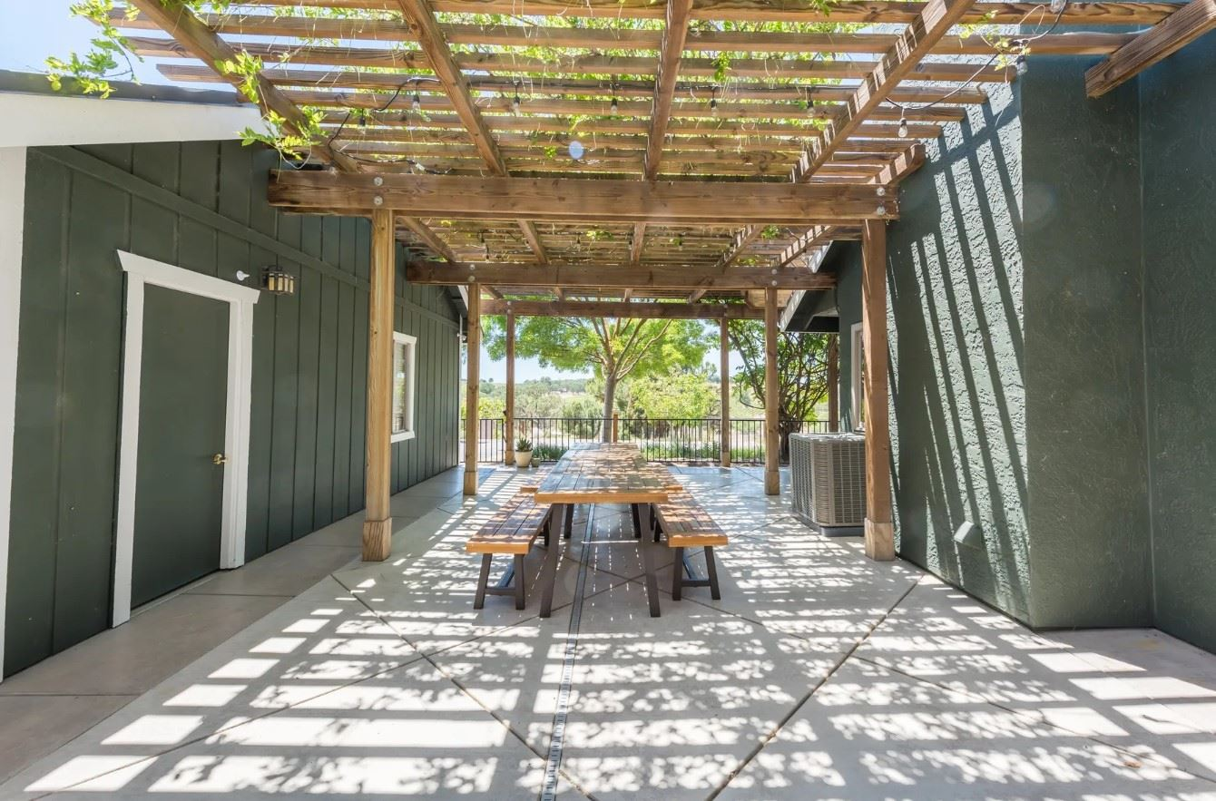 Harvest Ridge Ranch - Exterior - Picnic Dining Table on tiled patio under long pergola