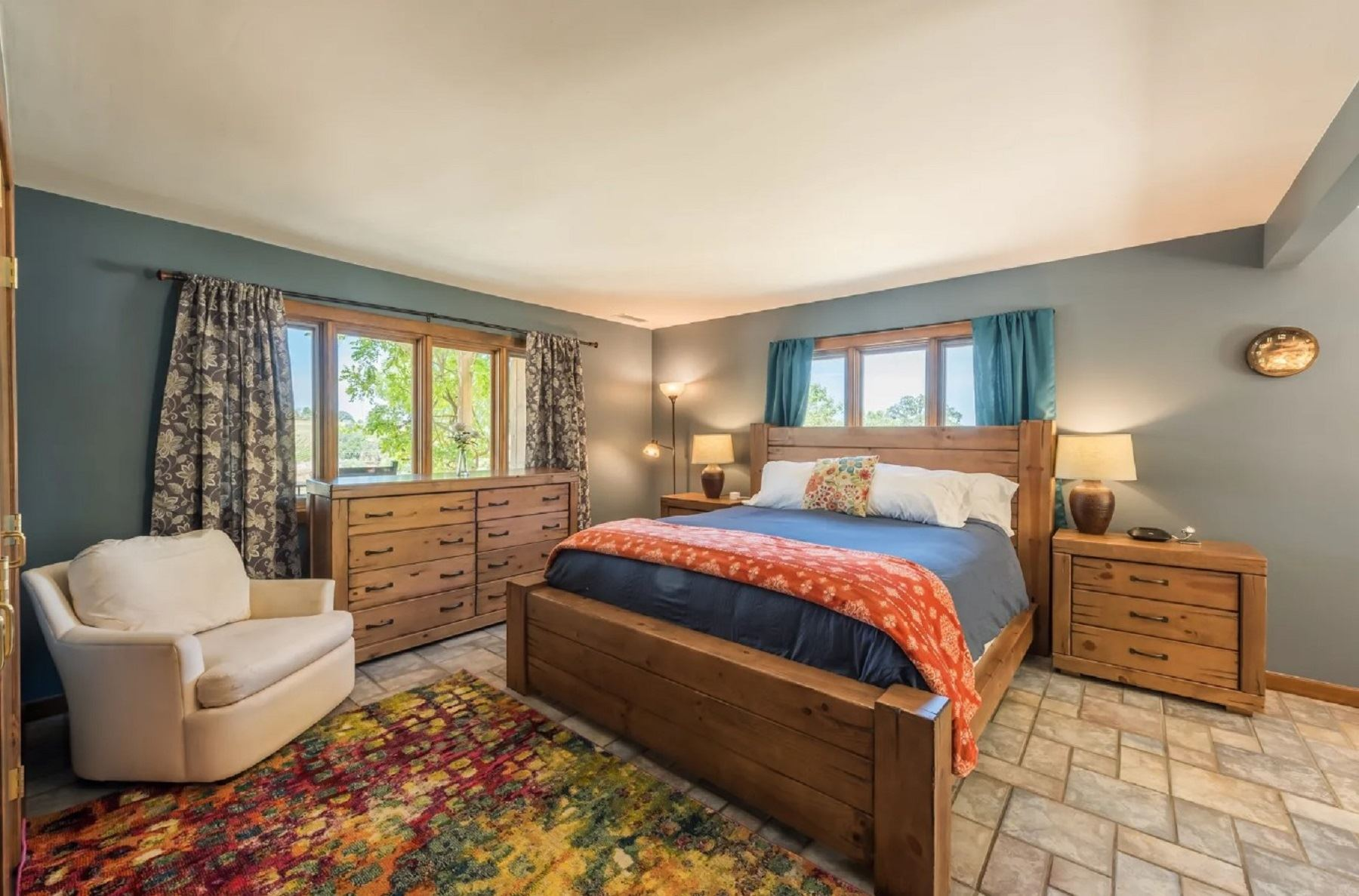 Harvest Ridge Ranch - Interior - Bedroom with view of rug and recliner by the bed
