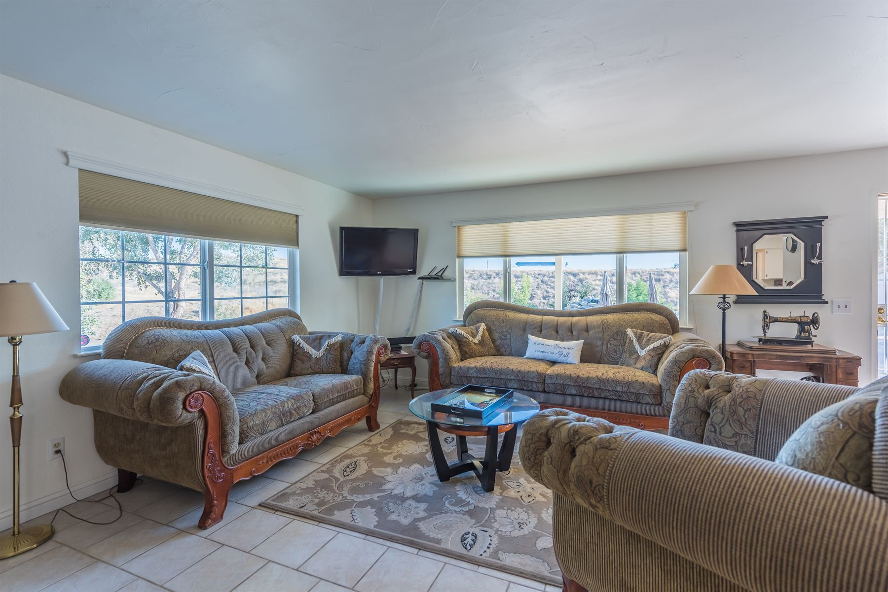 Oak Pass Ranch - Interior - Living room with two couches and one plush chair