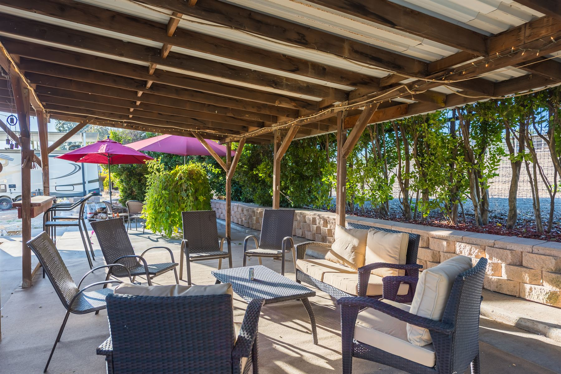 Oak Pass Ranch - Exterior - Seating area under veranda with seating for six