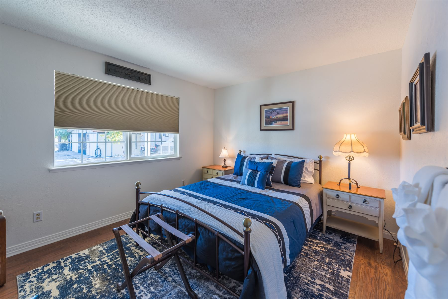 Oak Pass Ranch - Interior - Bedroom with blue linens on bed
