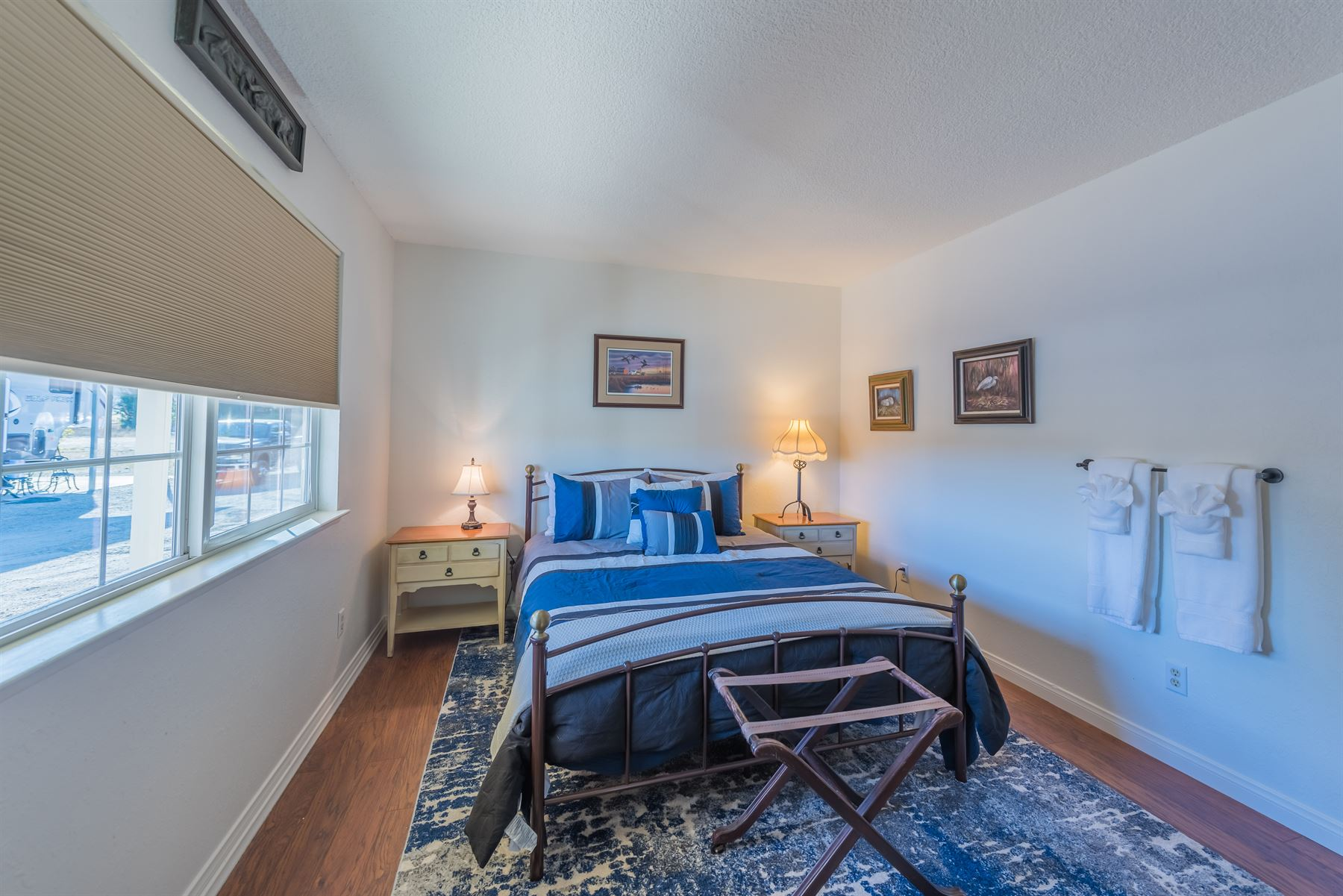 Oak Pass Ranch - Interior - Bedroom with blue linens wide shot