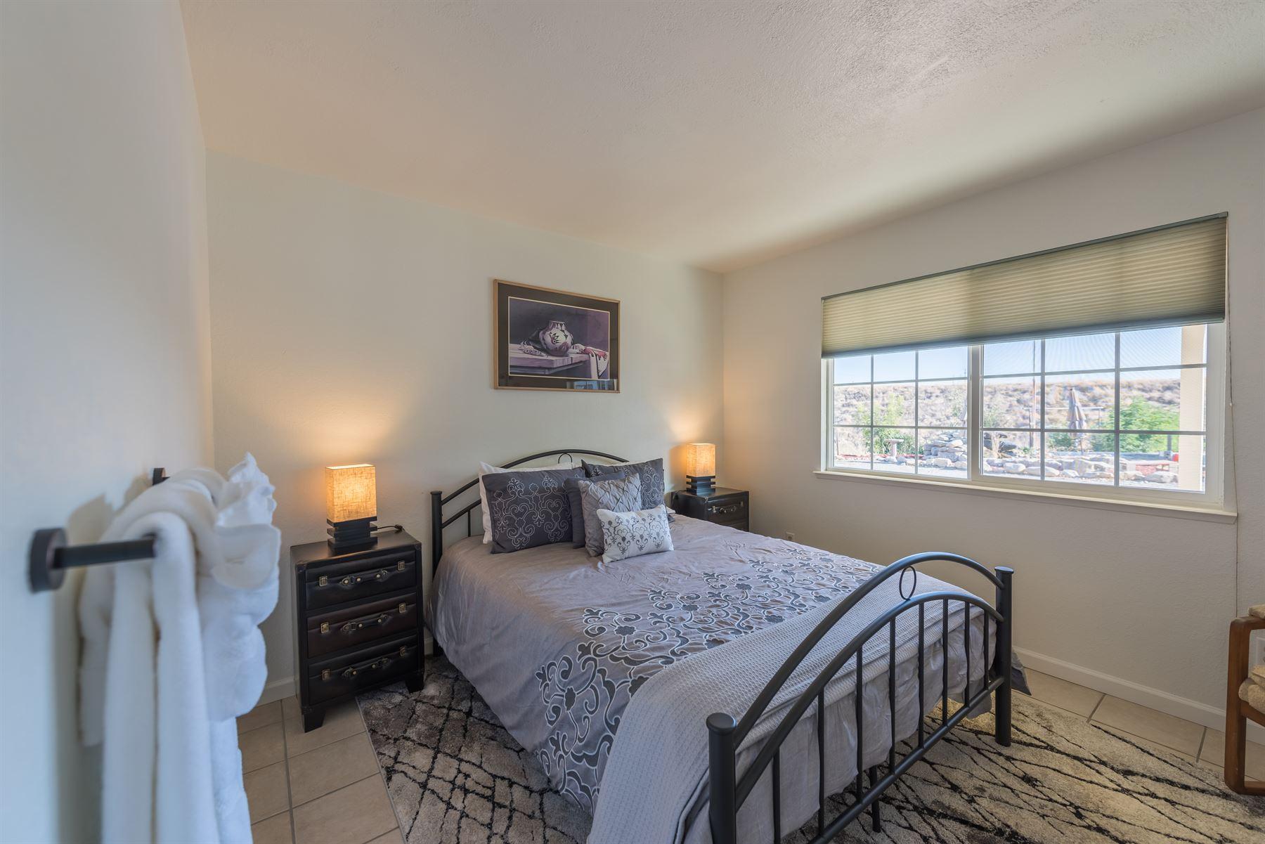 Oak Pass Ranch - Interior - Bedroom with grey linens