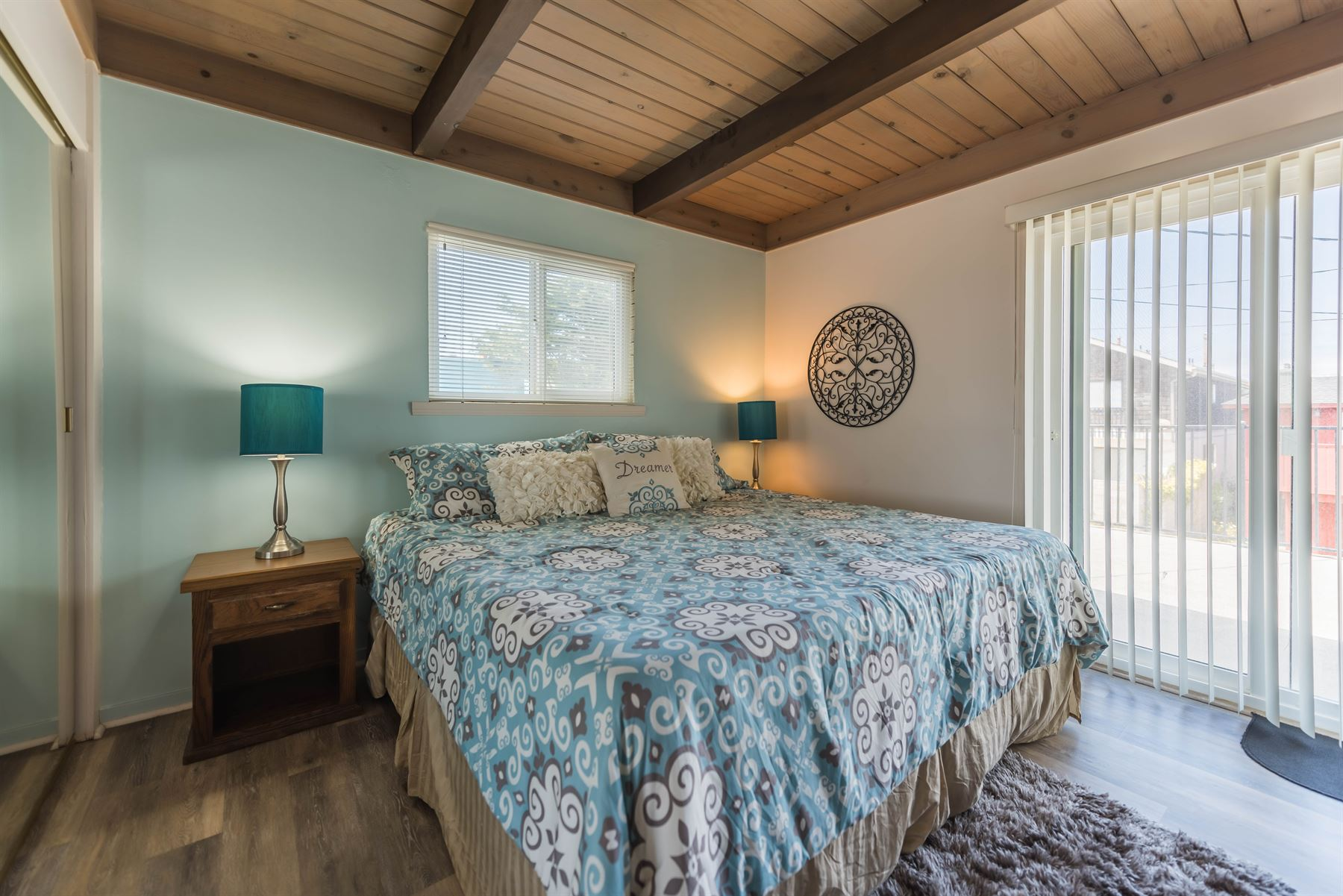 Oceanview Hideaway - Interior - Bedroom with blue and white linens on queen bed