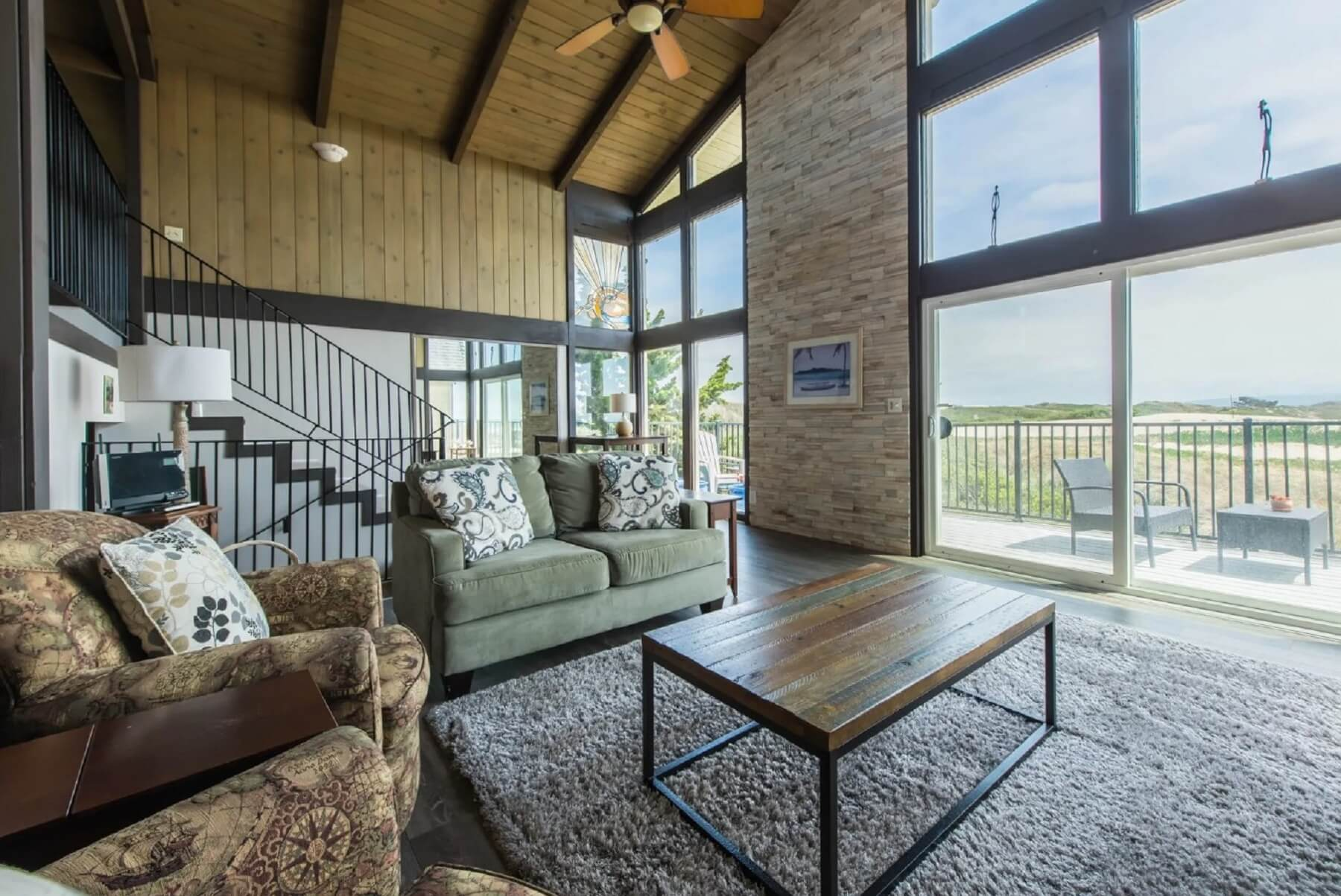 Oceanview Hideaway - Interior - Living Area with two story windows that show the view and porch