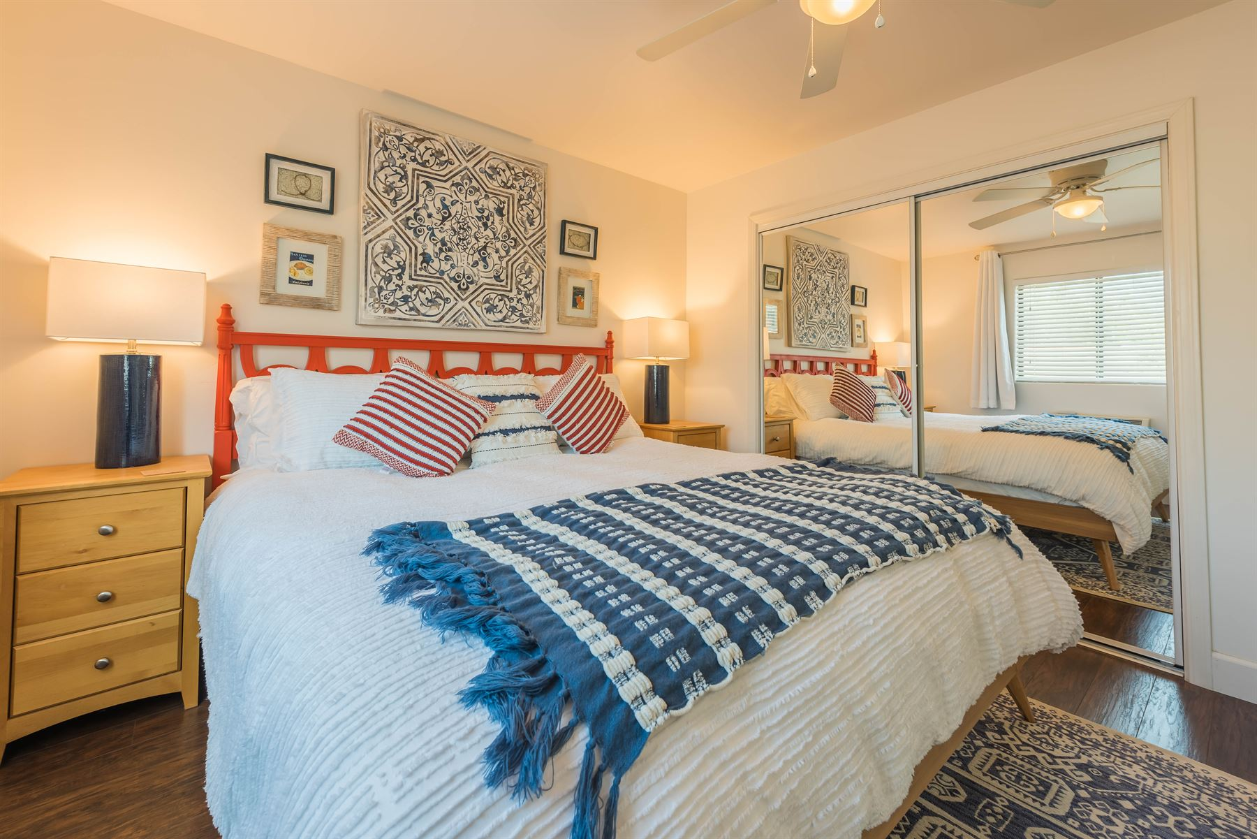 Wine County Casita - Interior - Bedroom with king bed that has a blue and white knitted duvet