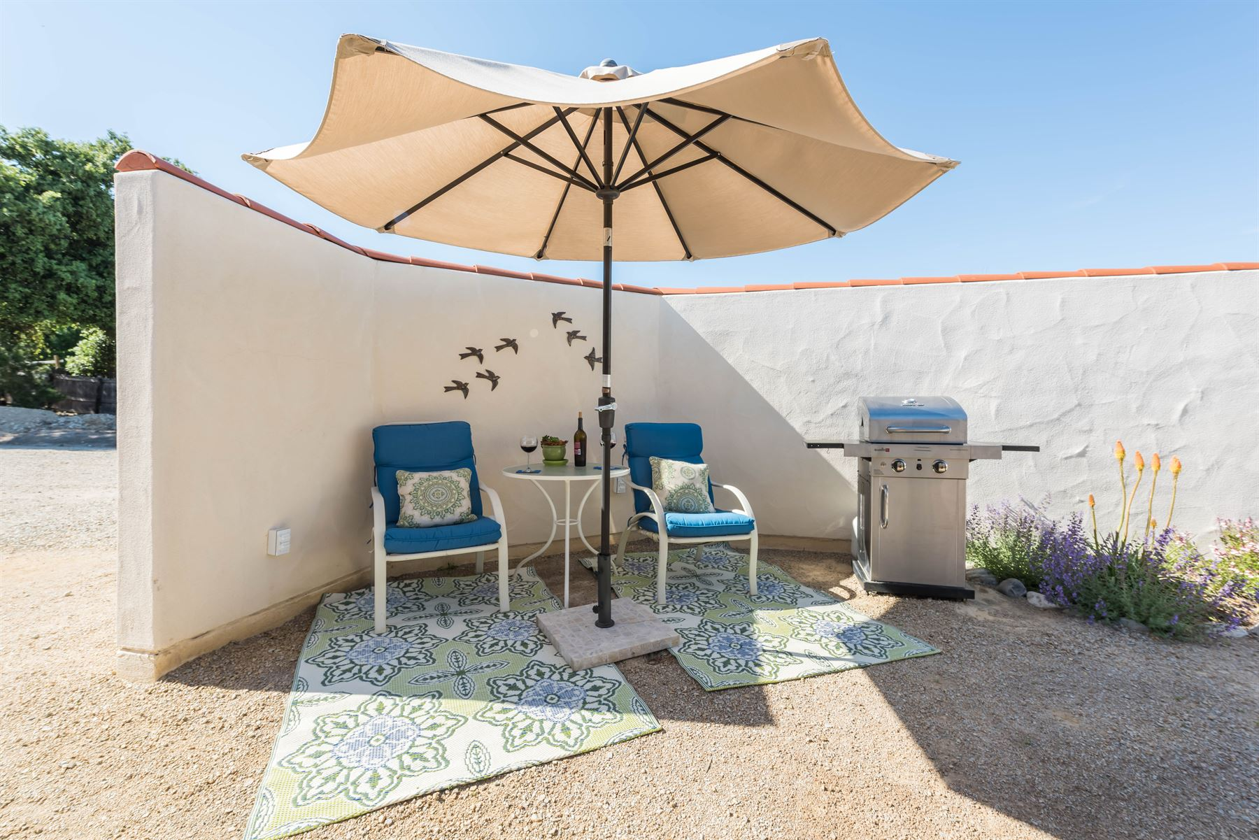Wine County Casita - Exterior - Shaded chairs by front door