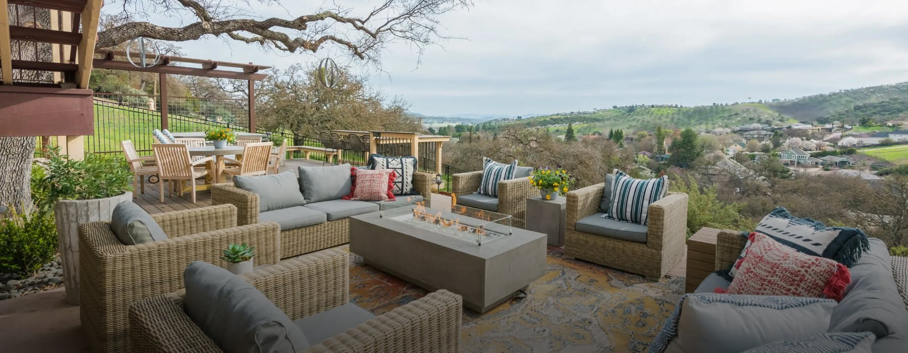Wide shot of Wine Country Dig patio with seating and gorgeous view