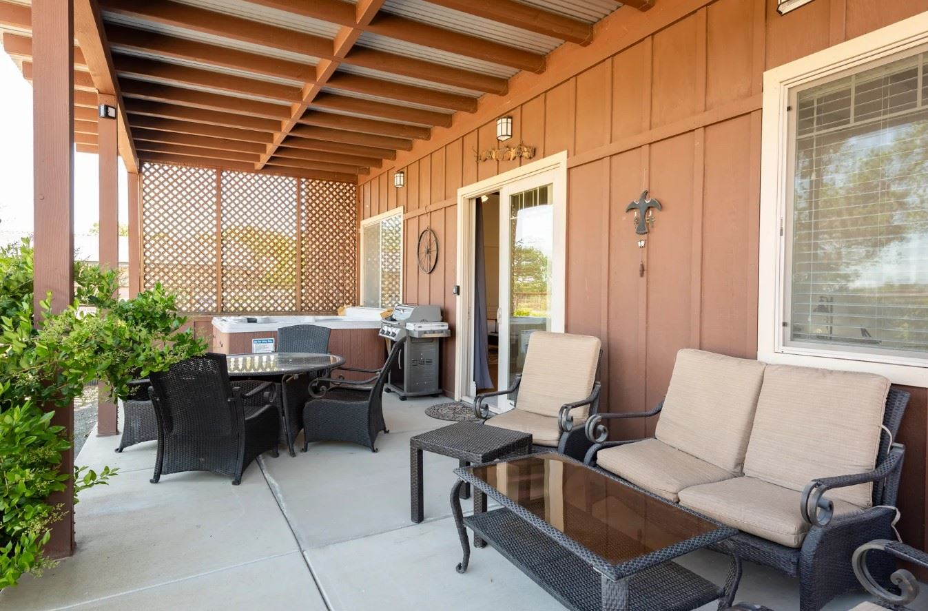 Frontier Hideaway - View of patio with seating for seven and a grill and hot tub