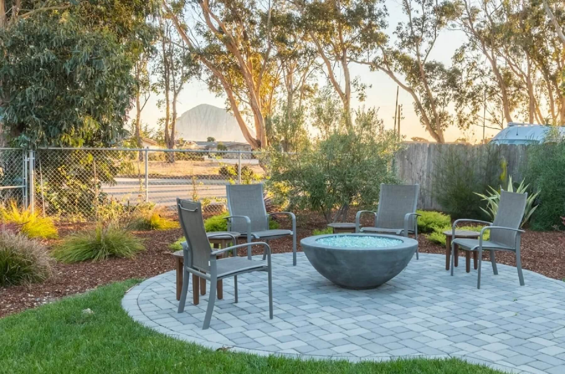 Morro Bay Rock Revival - Exterior - Fire Pit with seating and Morro Rock view