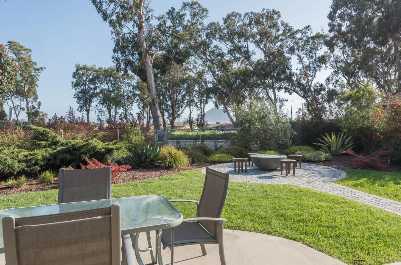 Morro Bay Rock Revival - Exterior - Outdoor seating area for four and a firepit with seating for four