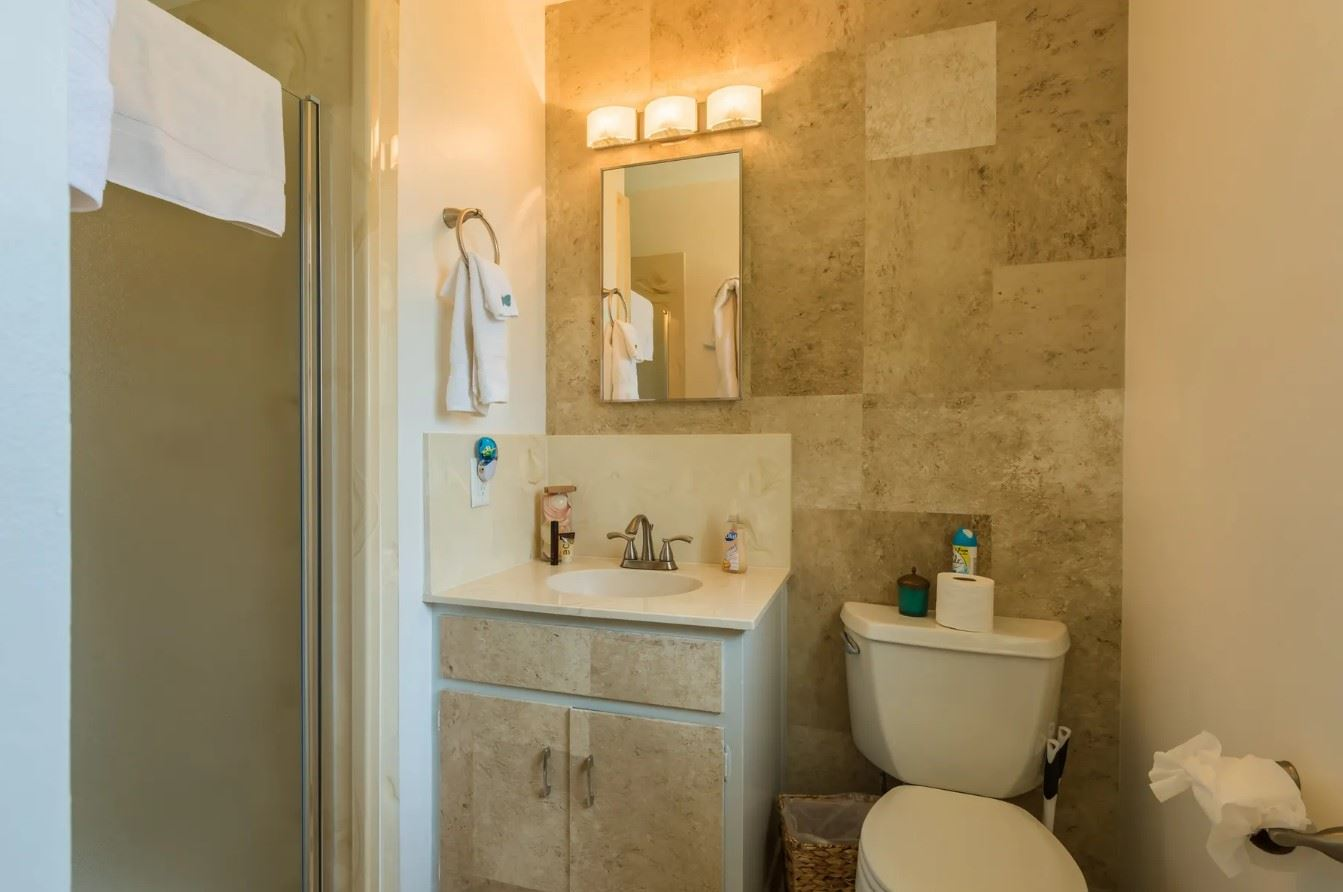 Morro Bay Rock Revival - Interior - Bathroom with sink toilet and shower
