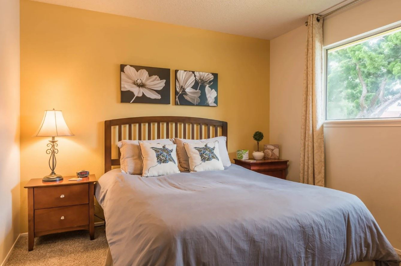 Morro Bay Rock Revival - Interior - Bedroom with yellow accent wall