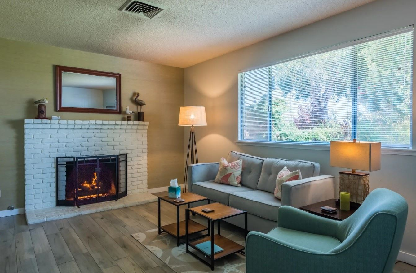 Morro Bay Rock Revival - Interior - Living Room with lit fireplace